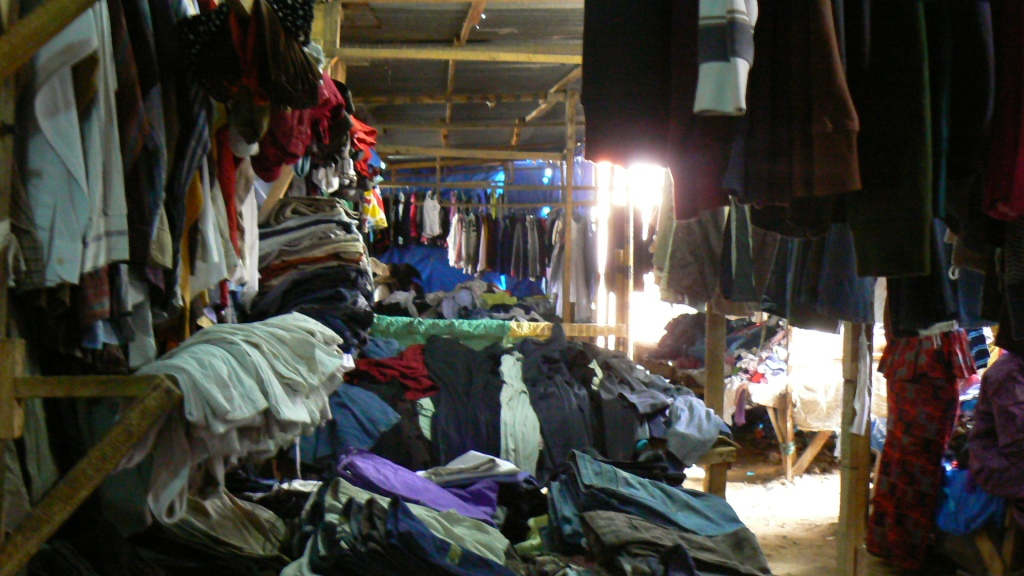 If you ever wondered where discarded charity shop clothes end up... It was difficult to leave this cavernous shed of wonders without an entire new wardrobe.