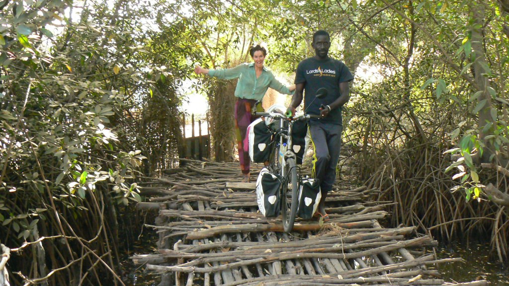 A great bridge on the way to the beach, made of out bits of old mangroves. Male passersby often like to insist on escorting my bike over obstacles for me.